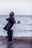 Fashionable Man Standing at the Sea with Open Arms Stock Images