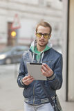 Fashionable Man On Street with Tablet Computer Royalty Free Stock Photography