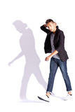 Fashionable man walking and looking at the camera Stock Photography