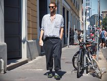 MILAN, ITALY -JUNE 18, 2018: Fashionable man walking in the street after AALTO fashion show, during Milan Fashion Week Men and wom stock photography