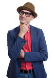 Fashionable man wearing glasses. Thinking and looking up Stock Photo