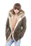 Fashionable man wearing parka. Portrait of relaxed fashionable man wearing parka overcoat with bare chest, isolated on white background Stock Photography