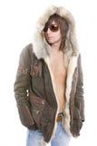 Fashionable man wearing parka. Portrait of relaxed fashionable man wearing parka overcoat with bare chest, isolated on white background Royalty Free Stock Image