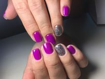 fashionable manicure of fuchsia with silver design royalty free stock photo