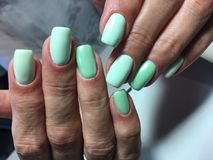fashionable manicure of turquoise color royalty free stock image