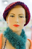 Fashionable mannequin. Fashionable female mannequin in hat and colorful feather boa Royalty Free Stock Images