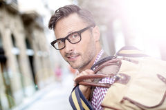 Fashionable mature man with bag in the streets Stock Image