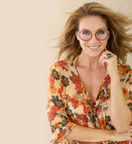Fashionable mature woman with red round eyeglasses Royalty Free Stock Image