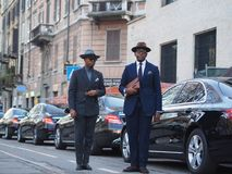 MILAN - January 13: Tw fashionable men posing in the street before NEIL BARRET fashion show, during Milan Fashion Week Fall/Winter stock photography
