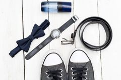Fashionable men`s accessories and shoes on a wooden background. Top view Stock Photography