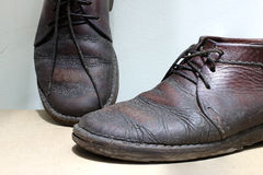 Fashionable men`s leather shoes on a dark abstract background. Autumn - spring shoes. brown boots closeup Stock Photo
