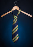 Fashionable men's tie on a hanger. On a blue background. Stock Photography
