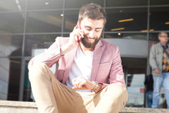 Fashionable men talking by mobile phone. Stock Image