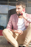 Fashionable men talking by mobile phone. Royalty Free Stock Image