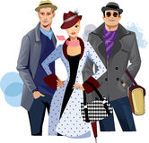Fashionable men and woman in coat Stock Images