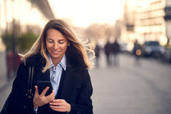 Fashionable middle-aged Woman in Black Coat royalty free stock photos