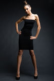 Fashionable model in black dress Stock Images