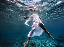 Fashionable model dancing underwater Stock Image