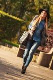 Fashionable model posing in park Stock Photos