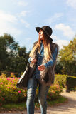 Fashionable model posing in park Stock Images
