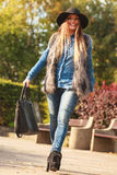 Fashionable model posing in park Royalty Free Stock Photo