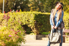 Fashionable model posing in park Royalty Free Stock Photography
