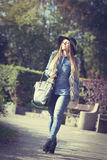 Fashionable model posing in park Royalty Free Stock Photos