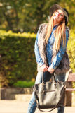 Fashionable model posing in park Royalty Free Stock Images