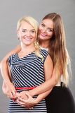 Fashionable mother and daughter posing together Stock Photography