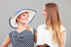 Fashionable mother and daughter posing together Stock Photo