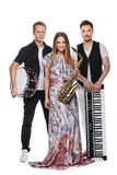 Fashionable music band posing full length over white background. Stock Photo