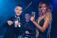 Fashionable music band posing. Stock Photo