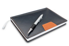 Fashionable notebook diary and modern pen. Stock Images