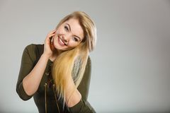 Attractive blonde woman wearing tight green khaki top stock photography