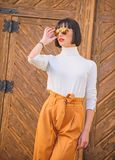 Fashionable outfit slim tall lady. Woman walk in elegant outfit. Fashion and style concept. Woman fashionable brunette. Stand outdoors wooden background. Girl stock photos