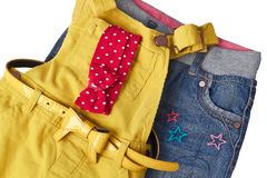 Fashionable overall with jeans  for small girl Stock Photography