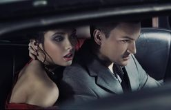 fashionable pair in a car Royalty Free Stock Images