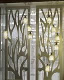 Fashionable pendant lamp in glass show window Stock Photo