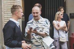 Fashionable people at Milan Men`s Fashion Week stock photo