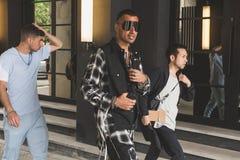 Fashionable people at Milan Men`s Fashion Week stock images