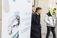 Fashionable people outside Magliano fashion show. MILAN, ITALY - JANUARY 12: Fashionable people are seen outside Magliano fashion show during Milan Men`s Fashion stock photo