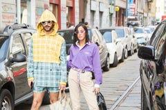 Fashionable people posing during Milan Women`s Fashion Week stock photos
