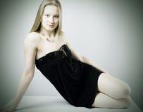 Fashionable photo sedentary girls Royalty Free Stock Image