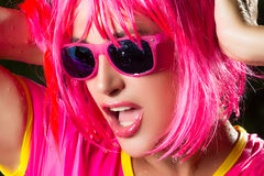 Fashionable Pink Party Girl. Sensual mouth. Portrait of beauty party girl with water drops Stock Photos