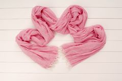 Fashionable pink scarf is on white background, showcase, Stock Photos