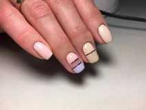 Fashionable pink with yellow manicure stock image