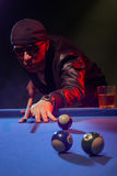 Fashionable pool player in a dark nightclub Stock Photos