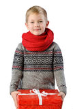 Fashionable Portrait of a adorable toddler boy in warm winter sweater and red scarf on white background with present box Royalty Free Stock Photography