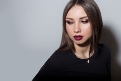 Fashionable portrait of a beautiful young sexy woman with bright fashion red lipstick and bright evening make-up on a white Royalty Free Stock Image