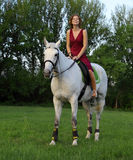 Fashionable portrait of a beautiful young woman and horse Stock Photography